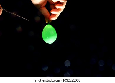 Water balloon burst as background / A water balloon or water bomb is a latex rubber balloon filled with water.