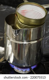 Water bath to melt wax in a can over the stove top. Series on making craft candles.