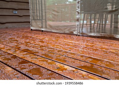 Water beads up on a freshly sealed wood deck after a morning rainstorm at the cottage.