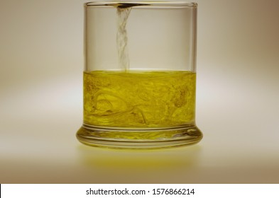 Water being poured into oil