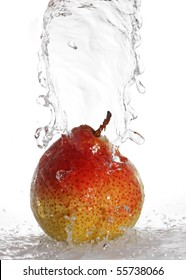 water being poured on a pear isolated on white
