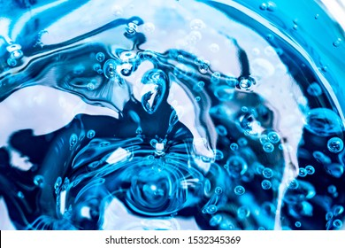 Water blue gel balls. Polymer gel. Silica gel. Balls of blue hydrogel. Crystal liquid ball with reflection. Texture background. Close up macro. Soapsuds background with air bubbles