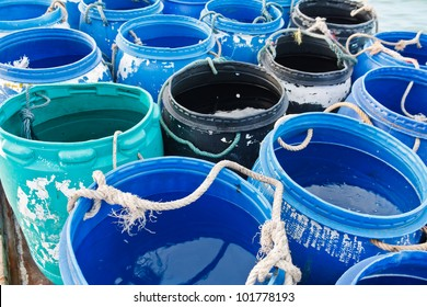water in blue plastic 200 litre open top barrel on the boat
