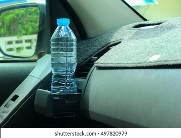 Water bottle placed on the car.