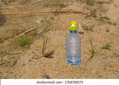 water bottle in the sand