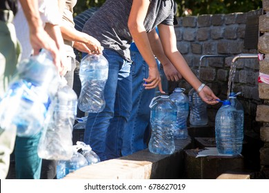 Water bottles being filled with Spring water at Newlands Spring Water Cape Town South Africa