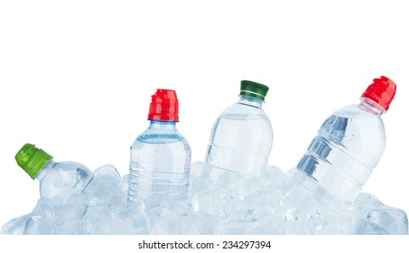 Water bottles in ice cube isolated on a white background