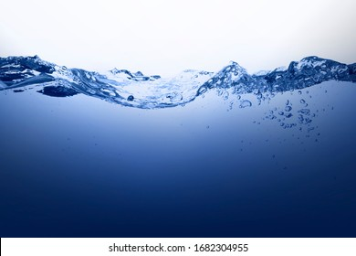 Water and bubbles surface isolated on white.blue water with splash, waves and air bubbles.Deep blue sea background