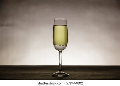 Water bubbles in tall champagne glass