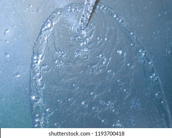 Water bubbling on sheet metal.