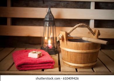 Water bucket, towel and soap in finnish sauna