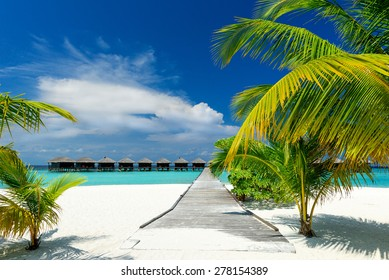water bungalows on a beautiful beach