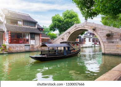 Water canals and gondolas in the ancient watertown of Tongli, China, close to Shanghai