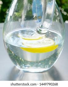 Water carafe with lemon slice