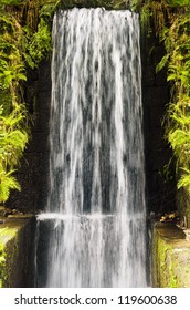 Water Cascade Falls From A High Wall