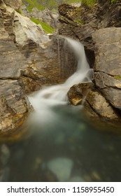 Water cascade in a small rocky gorge, long exposition