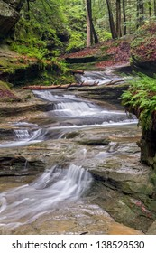 Water cascades down a sandstone stream bed in the forest of Ohio's Hocking Hills State Park in the area of Old Man's Cave.