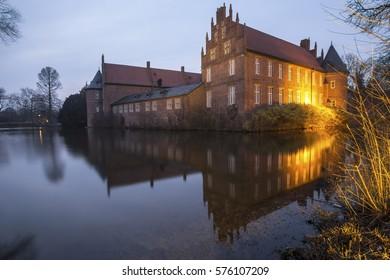 water castle herten germany in the evening