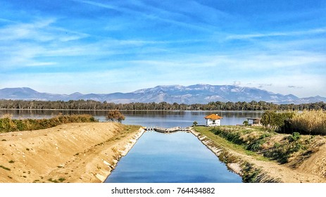 Water channel on lake with mountain and little house