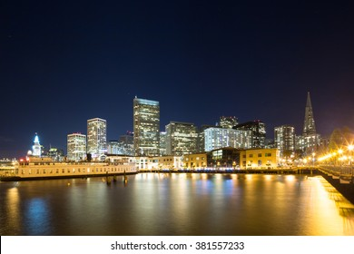 water with cityscape of San Francisco at night