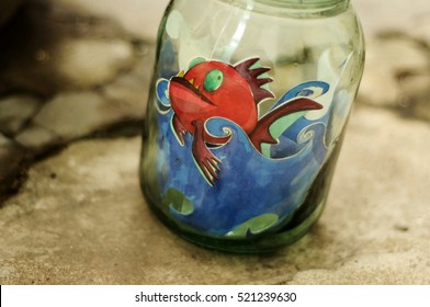 Water color painting inside a glass vase.