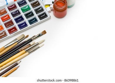 Water color paints and brushes on a white background