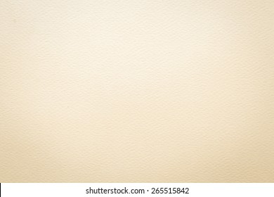 Water color paper texture background in light beige tone with vignette