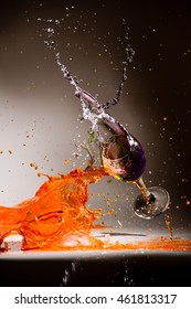 Water color splashing in glass wine on isolated background