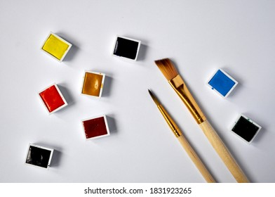 Water color tabs with paint brushes on white