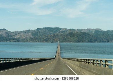 The water of the Columbia River at its mouth crossed by the Astoria - Megler Bridge in Astoria, Oregon, USA.
