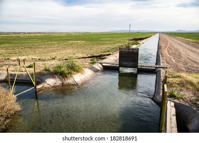 Water control gate on an agricultural  irrigation ditch in California