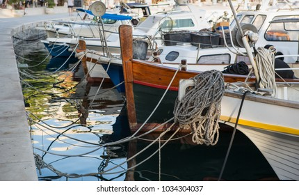 Water crafts tied with rope on pier at popular tourist area in Croatia.Rent motor boat,yacht for summer vacation tour to exotic islands.travel destination for summer vacation cruise.boats in haven