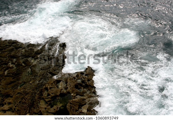 Water crashing against rocks