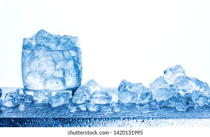Water with crushed ice cubes in glass isolated on white background with copy space