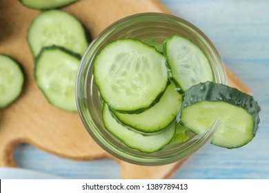water with cucumber. Refreshing diet water with cucumber and mint in a glass beaker against a blue background. detox drink concept. summer refreshing drink. top view