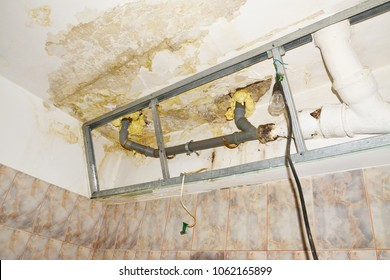 Water damage in condo bathroom ceiling, flooding from upstairs neighbor