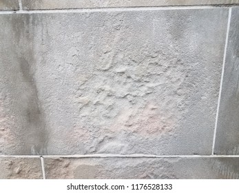 water damage on grey cement or stone wall