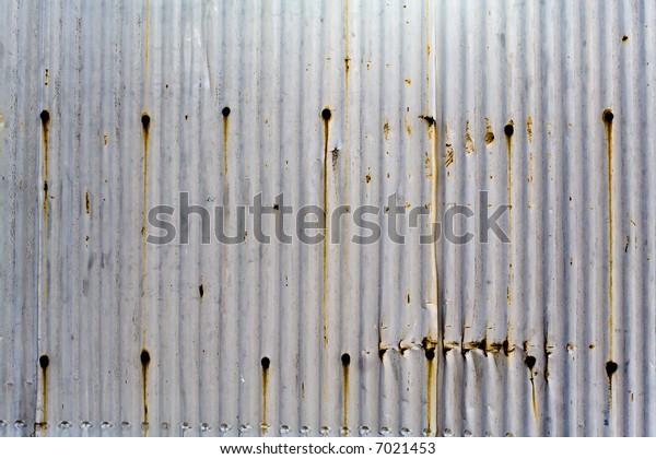 Water Damaged Metal Paneling with Screws, Texture Background, Horizontal