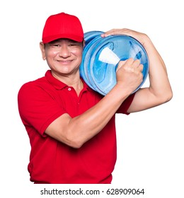 Water delivery. Cheerful delivery man holding a water jug while isolated on white background.