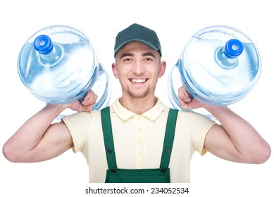 Water delivery courier is holding a two bottles on his shoulder, isolated on white background.