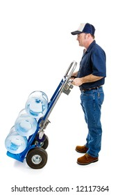 Water delivery man with three jugs of water loaded on a hand cart.  Profile view isolated on white.