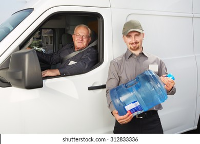 Water delivery service man with big bottle.