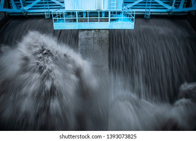 Water discharge on the dam. Water dumping