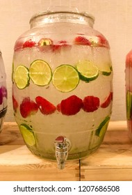 Water dispenser with strawberries and lime