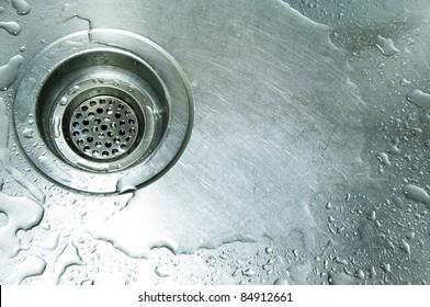 water drain in the metal sink