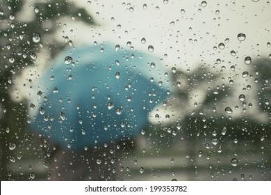 Water drop and blurred umbrella