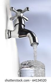 water drop from metal tap
