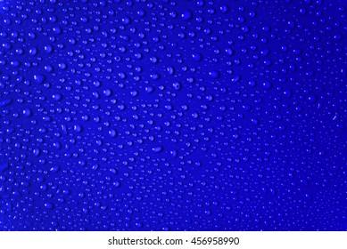 Water drop on dark blue color