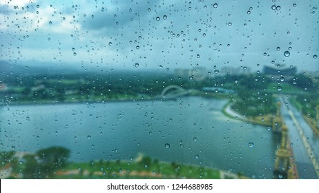 water drop on mirror during rainy days with blurred landscape in PICC, PUTRAJAYA