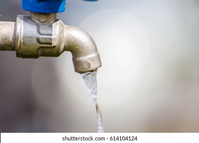 water drop from tap,Leaking water